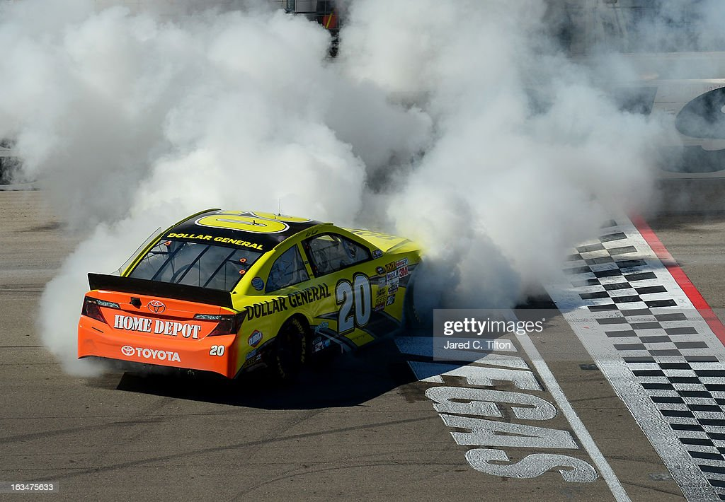 <a gi-track='captionPersonalityLinkClicked' href=/galleries/search?phrase=Matt+Kenseth&family=editorial&specificpeople=204192 ng-click='$event.stopPropagation()'>Matt Kenseth</a>, driver of the #20 Dollar General Toyota, celebrates with a burn out after winning the NASCAR Sprint Cup Series Kobalt Tools 400 at Las Vegas Motor Speedway on March 10, 2013 in Las Vegas, Nevada.