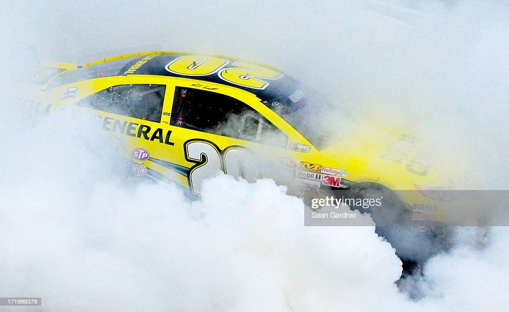 Matt Kenseth, driver of the #20 Dollar General Toyota, celebrates with a burnout after winning the NASCAR Sprint Cup Series Quaker State 400 at Kentucky Speedway on June 30, 2013 in Sparta, Kentucky.
