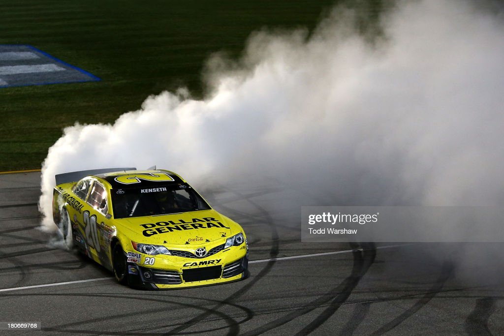 Matt Kenseth, driver of the #20 Dollar General Toyota, celebrates with a burnout after winning the NASCAR Sprint Cup Series Geico 400 at Chicagoland Speedway on September 15, 2013 in Joliet, Illinois.