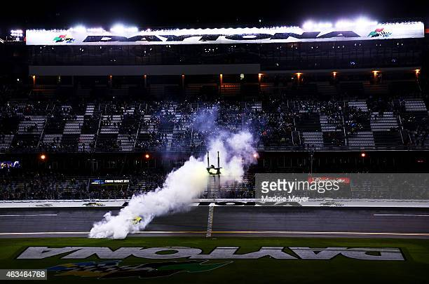 Matt Kenseth driver of the Dollar General Toyota celebrates with a burnout after winning the 3rd Annual Sprint Unlimited at Daytona at Daytona...