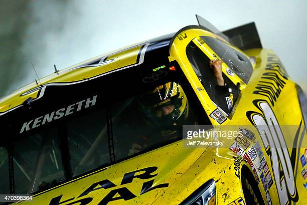 Matt Kenseth driver of the Dollar General Toyota celebrates with a burnout after winning the NASCAR Sprint Cup Series Food City 500 at Bristol Motor...