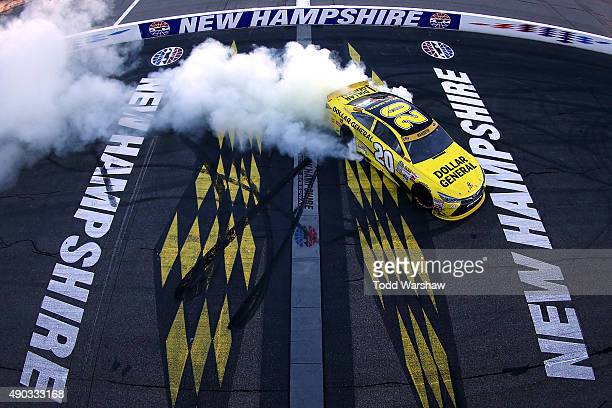 Matt Kenseth driver of the Dollar General Toyota celebrates with a burnout after winning the NASCAR Sprint Cup Series SYLVANIA 300 at New Hampshire...