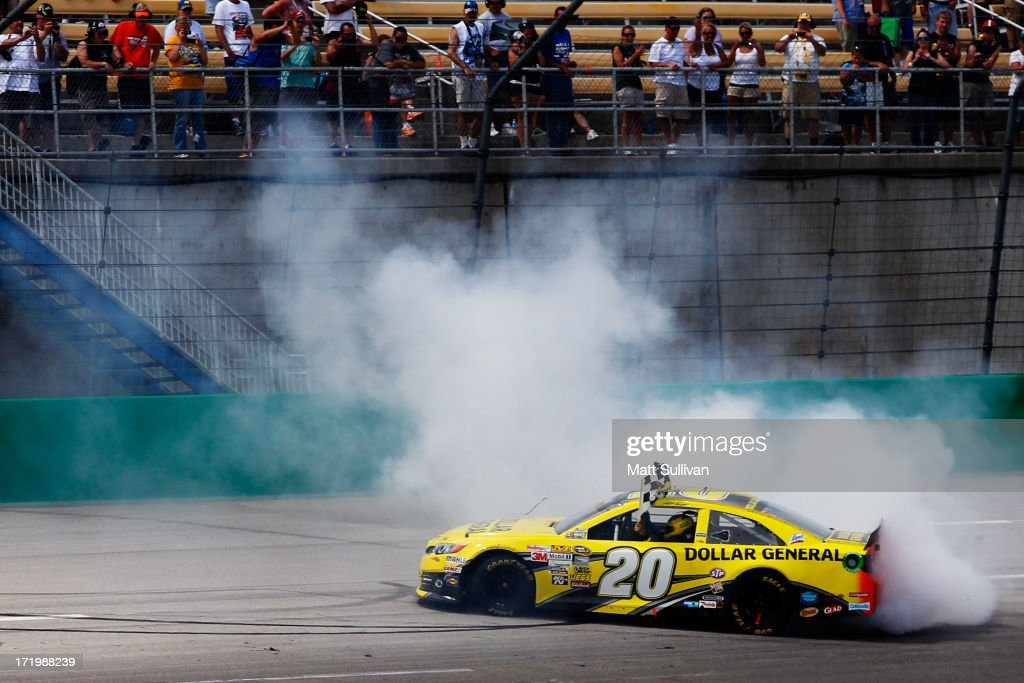 <a gi-track='captionPersonalityLinkClicked' href=/galleries/search?phrase=Matt+Kenseth&family=editorial&specificpeople=204192 ng-click='$event.stopPropagation()'>Matt Kenseth</a>, driver of the #20 Dollar General Toyota, celeebrates with a burnout after winning the NASCAR Sprint Cup Series Quaker State 400 at Kentucky Speedway on June 30, 2013 in Sparta, Kentucky.