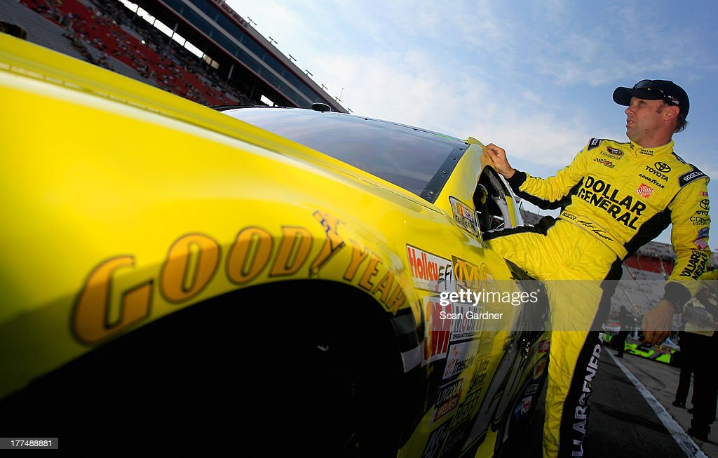 <a gi-track='captionPersonalityLinkClicked' href=/galleries/search?phrase=Matt+Kenseth&family=editorial&specificpeople=204192 ng-click='$event.stopPropagation()'>Matt Kenseth</a>, driver of the #20 Dollar General Toyota, climbs from his car after qualifying for the NASCAR Sprint Cup Series IRWIN Tools Night Race at Bristol Motor Speedway on August 23, 2013 in Bristol, Tennessee.