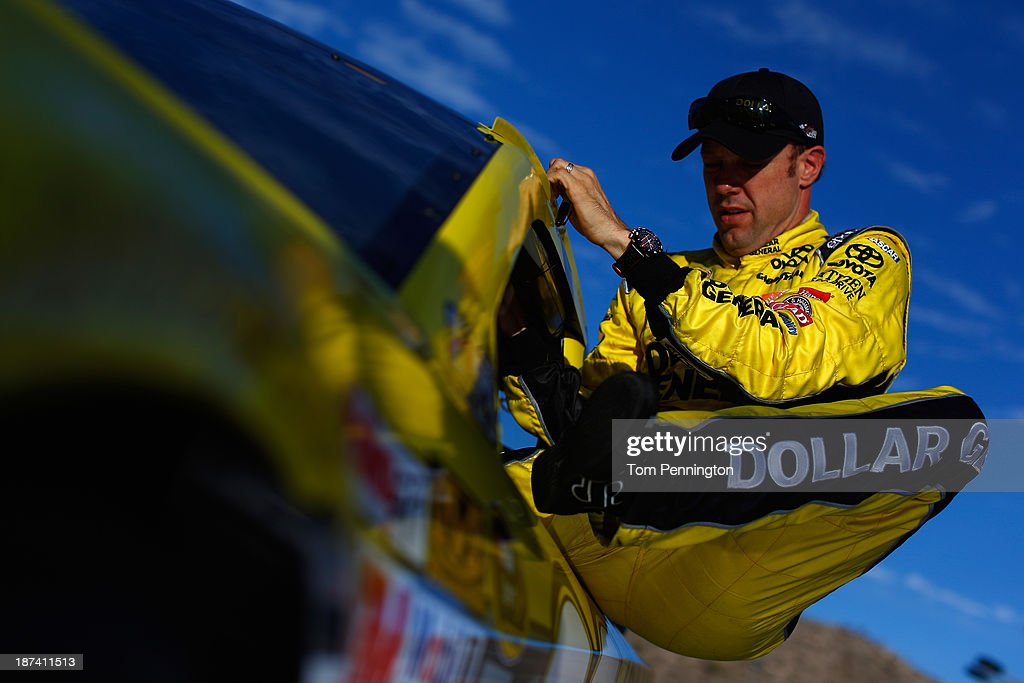 <a gi-track='captionPersonalityLinkClicked' href=/galleries/search?phrase=Matt+Kenseth&family=editorial&specificpeople=204192 ng-click='$event.stopPropagation()'>Matt Kenseth</a>, driver of the #20 Dollar General Toyota, climbs from his car during qualifying for the NASCAR Sprint Cup Series Advocare 500 at Phoenix International Raceway on November 8, 2013 in Avondale, Arizona.