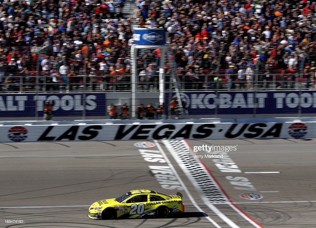 <a gi-track='captionPersonalityLinkClicked' href=/galleries/search?phrase=Matt+Kenseth&family=editorial&specificpeople=204192 ng-click='$event.stopPropagation()'>Matt Kenseth</a>, driver of the #20 Dollar General Toyota, crosses the finishline to win the NASCAR Sprint Cup Series Kobalt Tools 400 at Las Vegas Motor Speedway on March 10, 2013 in Las Vegas, Nevada.