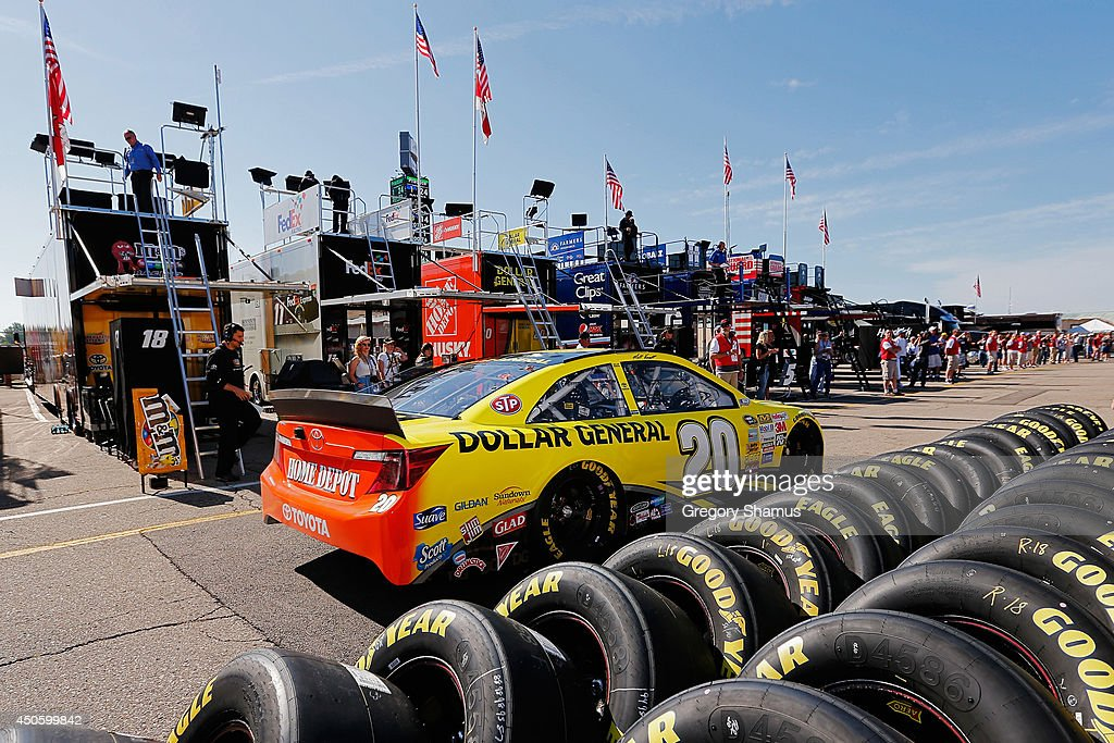 Matt Kenseth, driver of the #20 Dollar General Toyota, drives through the garage area during practice for the NASCAR Sprint Cup Series Quicken Loans 400 at Michigan International Speedway on June 14, 2014 in Brooklyn, Michigan.