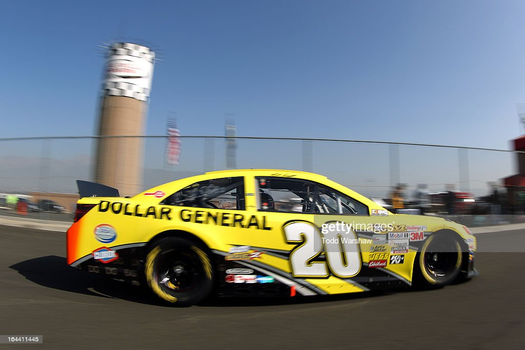 Matt Kenseth, driver of the #20 Dollar General Toyota, drives to the garage area during practice for the NASCAR Sprint Cup Series Auto Club 400 at Auto Club Speedway on March 23, 2013 in Fontana, California.