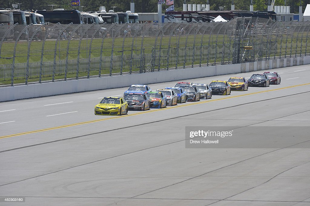 <a gi-track='captionPersonalityLinkClicked' href=/galleries/search?phrase=Matt+Kenseth&family=editorial&specificpeople=204192 ng-click='$event.stopPropagation()'>Matt Kenseth</a>, driver of the #20 Dollar General Toyota, leads a pack of cars during qualifying for the NASCAR Sprint Cup Series Aaron's 499 at Talladega Superspeedway on May 3, 2014 in Talladega, Alabama.