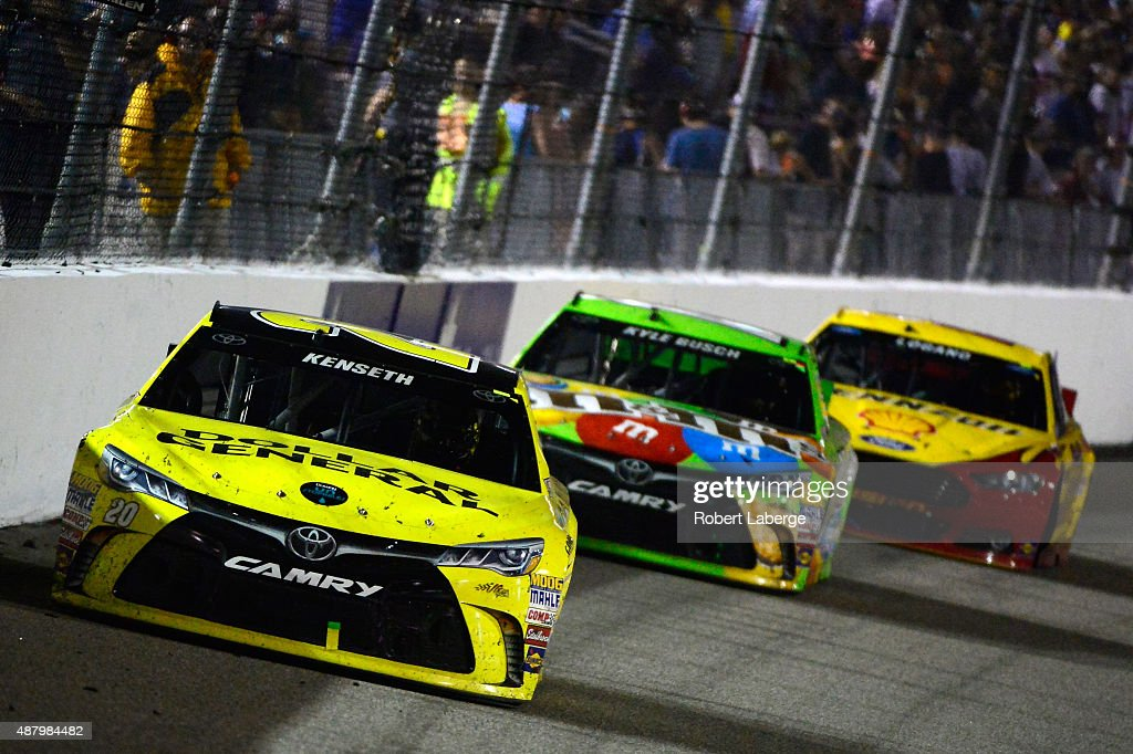 Matt Kenseth driver of the Dollar General Toyota leads a pack of cars during the NASCAR Sprint Cup Series Federated Auto Parts 400 at Richmond...