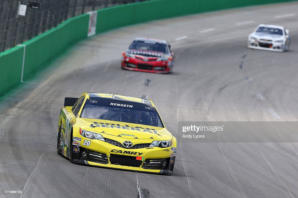 Matt Kenseth, driver of the #20 Dollar General Toyota, leads Clint Bowyer, driver of the #15 Camry 30th Anniversary Toyota, and Jimmie Johnson, driver of the #48 Lowe's Dover White Chevrolet, during the NASCAR Sprint Cup Series Quaker State 400 at Kentucky Speedway on June 30, 2013 in Sparta, Kentucky.