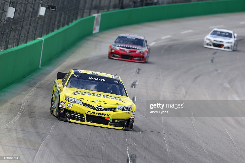 <a gi-track='captionPersonalityLinkClicked' href=/galleries/search?phrase=Matt+Kenseth&family=editorial&specificpeople=204192 ng-click='$event.stopPropagation()'>Matt Kenseth</a>, driver of the #20 Dollar General Toyota, leads <a gi-track='captionPersonalityLinkClicked' href=/galleries/search?phrase=Clint+Bowyer&family=editorial&specificpeople=537951 ng-click='$event.stopPropagation()'>Clint Bowyer</a>, driver of the #15 Camry 30th Anniversary Toyota, and <a gi-track='captionPersonalityLinkClicked' href=/galleries/search?phrase=Jimmie+Johnson+-+Nascar+Race+Driver&family=editorial&specificpeople=171519 ng-click='$event.stopPropagation()'>Jimmie Johnson</a>, driver of the #48 Lowe's Dover White Chevrolet, during the NASCAR Sprint Cup Series Quaker State 400 at Kentucky Speedway on June 30, 2013 in Sparta, Kentucky.