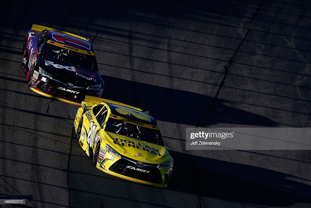 Matt Kenseth driver of the Dollar General Toyota leads Denny Hamlin driver of the FedEx Freight Toyota during the NASCAR Sprint Cup Series SYLVANIA...