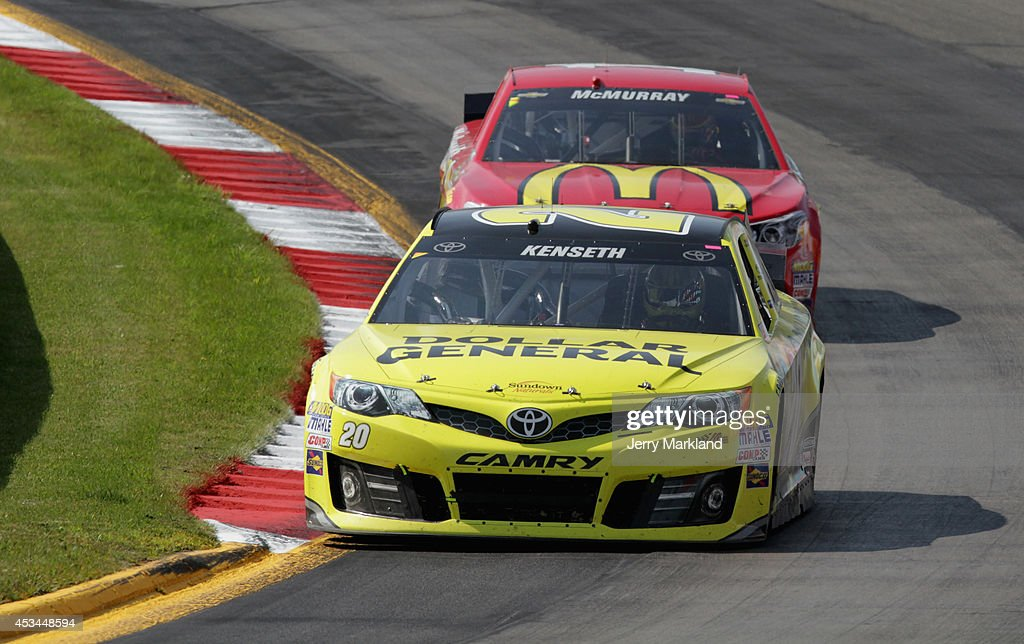 Matt Kenseth, driver of the #20 Dollar General Toyota, leads Jamie McMurray, driver of the #1 McDonald's Chevrolet, during the NASCAR Sprint Cup Series Cheez-It 355 at Watkins Glen International on August 10, 2014 in Watkins Glen, New York.