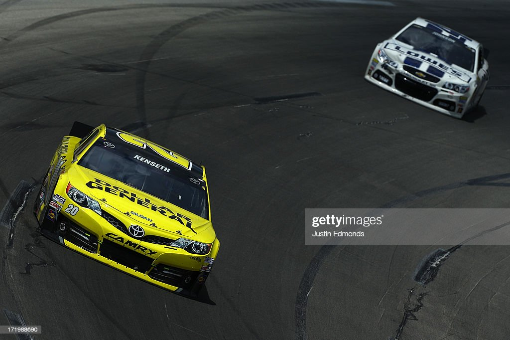 <a gi-track='captionPersonalityLinkClicked' href=/galleries/search?phrase=Matt+Kenseth&family=editorial&specificpeople=204192 ng-click='$event.stopPropagation()'>Matt Kenseth</a>, driver of the #20 Dollar General Toyota, leads <a gi-track='captionPersonalityLinkClicked' href=/galleries/search?phrase=Jimmie+Johnson+-+Nascar+Race+Driver&family=editorial&specificpeople=171519 ng-click='$event.stopPropagation()'>Jimmie Johnson</a>, driver of the #48 Lowe's Dover White Chevrolet, during the NASCAR Sprint Cup Series Quaker State 400 at Kentucky Speedway on June 30, 2013 in Sparta, Kentucky.