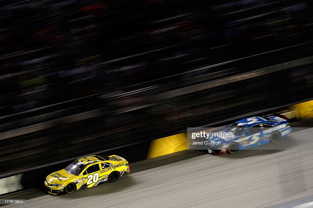 Matt Kenseth, driver of the #20 Dollar General Toyota, leads Kasey Kahne, driver of the #5 Farmers Insurance Chevrolet, during the NASCAR Sprint Cup Series 53rd Annual IRWIN Tools Night Race at Bristol Motor Speedway on August 24, 2013 in Bristol, Tennessee.