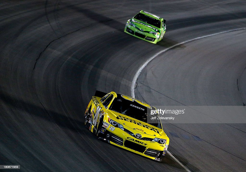 <a gi-track='captionPersonalityLinkClicked' href=/galleries/search?phrase=Matt+Kenseth&family=editorial&specificpeople=204192 ng-click='$event.stopPropagation()'>Matt Kenseth</a>, driver of the #20 Dollar General Toyota, leads <a gi-track='captionPersonalityLinkClicked' href=/galleries/search?phrase=Kyle+Busch&family=editorial&specificpeople=211123 ng-click='$event.stopPropagation()'>Kyle Busch</a>, driver of the #18 Double Mint Gum Toyota, during the NASCAR Sprint Cup Series Geico 400 at Chicagoland Speedway on September 15, 2013 in Joliet, Illinois.