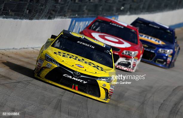 Matt Kenseth driver of the Dollar General Toyota leads Kyle Larson driver of the Target Chevrolet and Chase Elliott driver of the NAPA Auto Parts...