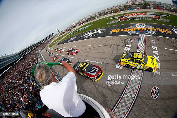 Matt Kenseth driver of the Dollar General Toyota leads the field past the green flag to start the NASCAR Sprint Cup Series AAA Texas 500 at Texas...