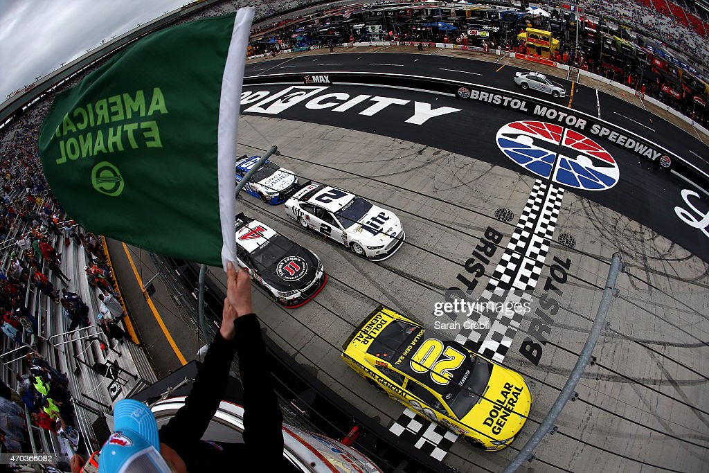 Matt Kenseth driver of the Dollar General Toyota leads the field through the green flag to start the NASCAR Sprint Cup Series Food City 500 at...