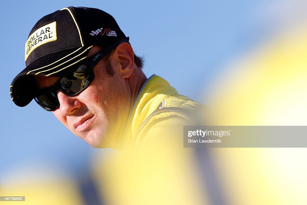 <a gi-track='captionPersonalityLinkClicked' href=/galleries/search?phrase=Matt+Kenseth&family=editorial&specificpeople=204192 ng-click='$event.stopPropagation()'>Matt Kenseth</a>, driver of the #20 Dollar General Toyota, looks on during qualifying for the NASCAR Sprint Cup Series Federated Auto Parts 400 at Richmond International Raceway on September 11, 2015 in Richmond, Virginia.