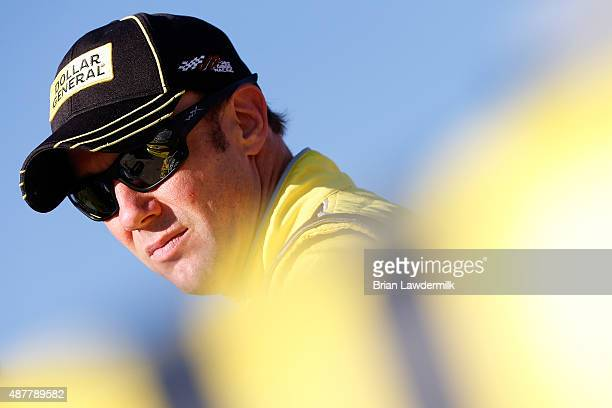 Matt Kenseth driver of the Dollar General Toyota looks on during qualifying for the NASCAR Sprint Cup Series Federated Auto Parts 400 at Richmond...
