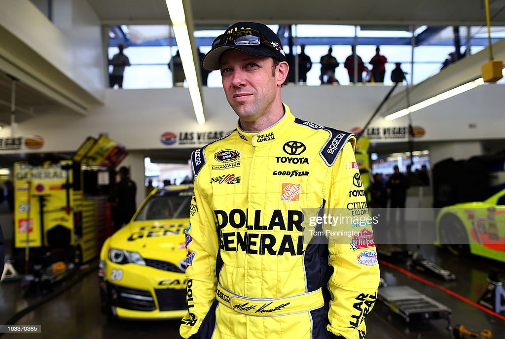 <a gi-track='captionPersonalityLinkClicked' href=/galleries/search?phrase=Matt+Kenseth&family=editorial&specificpeople=204192 ng-click='$event.stopPropagation()'>Matt Kenseth</a>, driver of the #20 Dollar General Toyota, looks on in the garage before practice for the NASCAR Sprint Cup Series at Las Vegas Motor Speedway on March 8, 2013 in Las Vegas, Nevada.