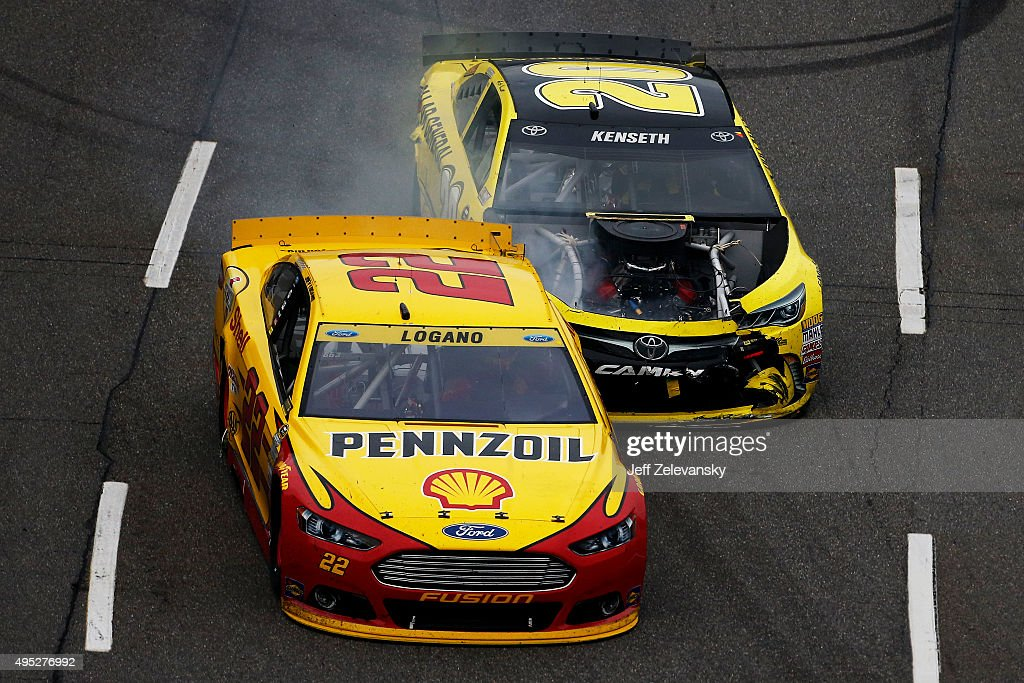 Matt Kenseth driver of the Dollar General Toyota makes contact with Joey Logano driver of the Shell Pennzoil Ford during the NASCAR Sprint Cup Series...