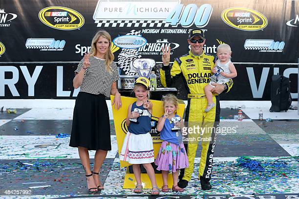Matt Kenseth driver of the Dollar General Toyota poses in victory lane with his wife Katie and daughters Kaylin Grace and Clara after winning the...
