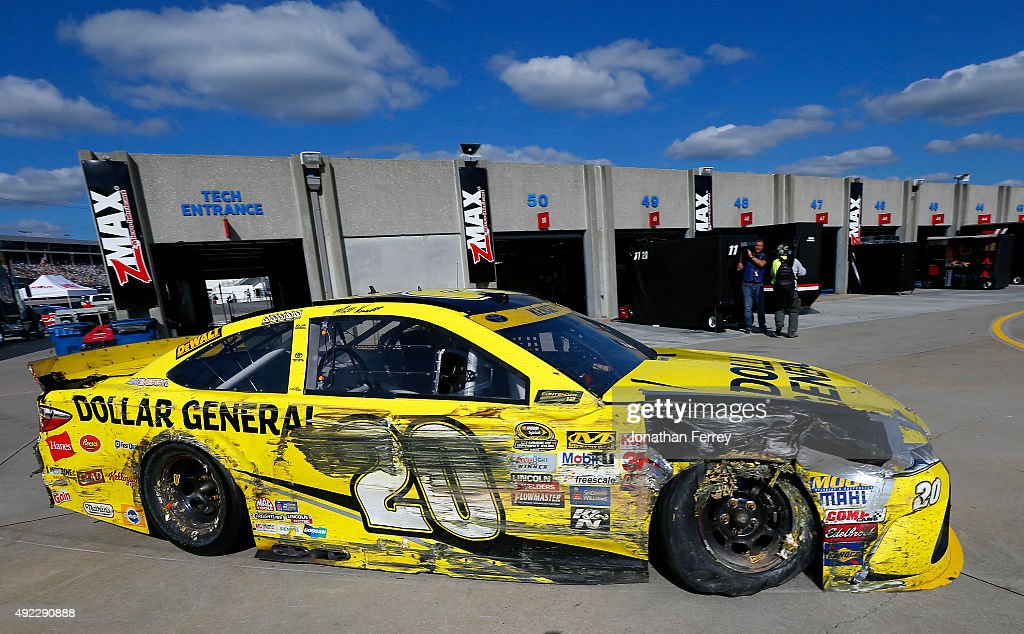 Matt Kenseth driver of the Dollar General Toyota pulls into the garage in his damaged car during the NASCAR Sprint Cup Series Bank of America 500 at...