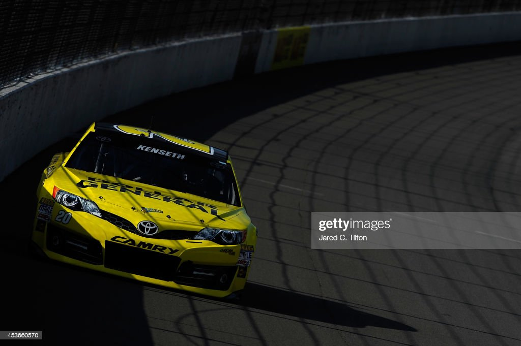 <a gi-track='captionPersonalityLinkClicked' href=/galleries/search?phrase=Matt+Kenseth&family=editorial&specificpeople=204192 ng-click='$event.stopPropagation()'>Matt Kenseth</a>, driver of the #20 Dollar General Toyota, qualifies for the NASCAR Sprint Cup Series Pure Michigan 400 at Michigan International Speedway on August 15, 2014 in Brooklyn, Michigan.