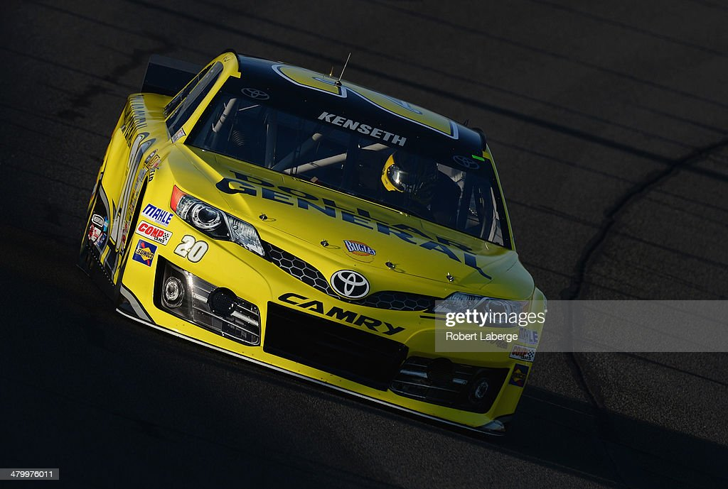 <a gi-track='captionPersonalityLinkClicked' href=/galleries/search?phrase=Matt+Kenseth&family=editorial&specificpeople=204192 ng-click='$event.stopPropagation()'>Matt Kenseth</a>, driver of the #20 Dollar General Toyota, qualifies for the NASCAR Sprint Cup Series Auto Club 400 at Auto Club Speedway on March 21, 2014 in Fontana, California.