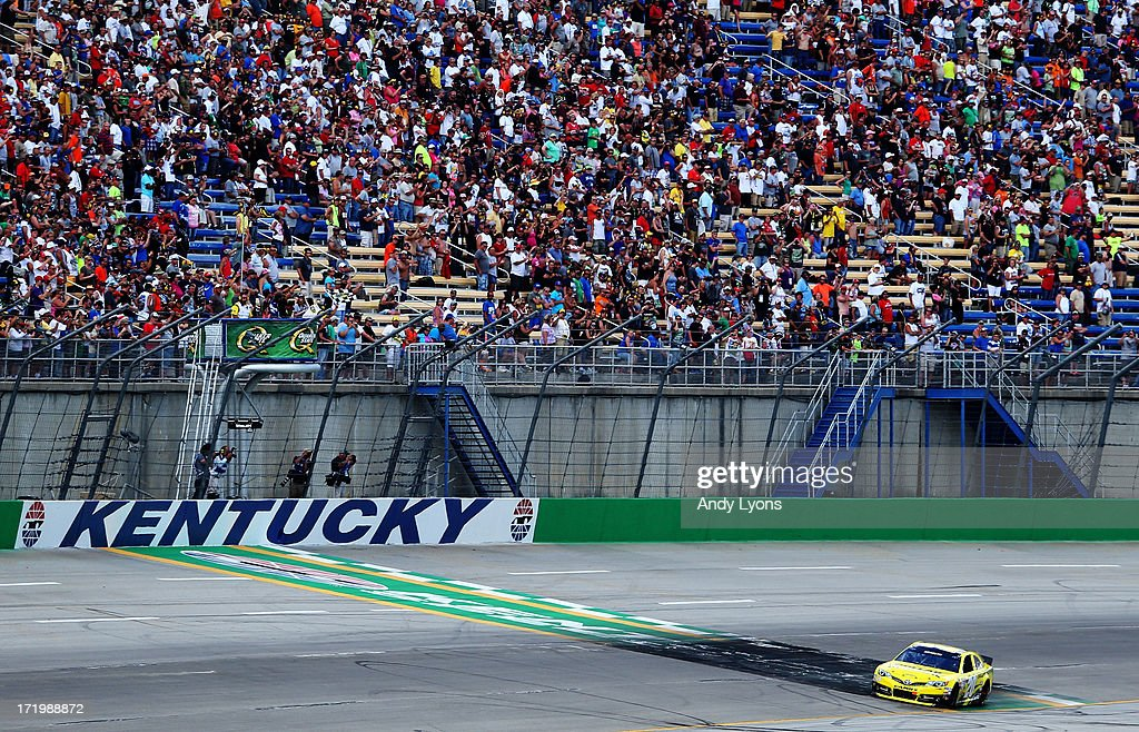 Matt Kenseth, driver of the #20 Dollar General Toyota, races across the finishline to win the NASCAR Sprint Cup Series Quaker State 400 at Kentucky Speedway on June 30, 2013 in Sparta, Kentucky.