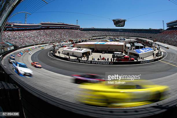 Matt Kenseth driver of the Dollar General Toyota races Denny Hamlin driver of the FedEx Freight Toyota during the NASCAR Sprint Cup Series Food City...
