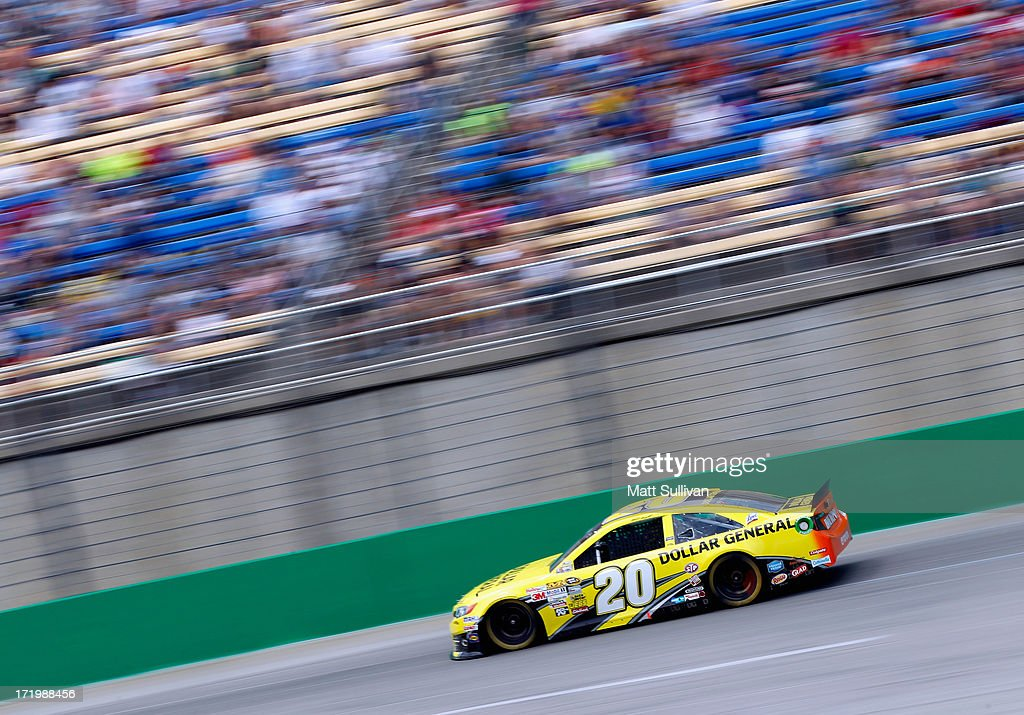 Matt Kenseth, driver of the #20 Dollar General Toyota, races during the NASCAR Sprint Cup Series Quaker State 400 at Kentucky Speedway on June 30, 2013 in Sparta, Kentucky.