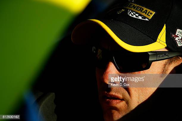 Matt Kenseth driver of the Dollar General Toyota sits in his car during qualifying for the NASCAR Sprint Cup Series Folds of Honor QuikTrip 500 at...