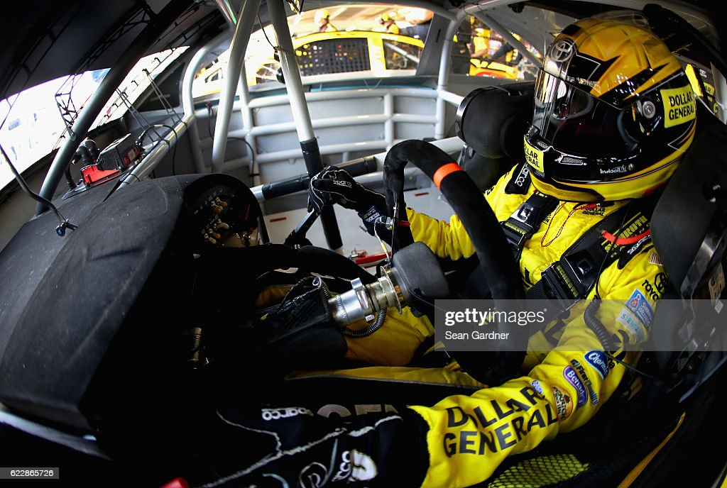 Matt Kenseth, driver of the #20 Dollar General Toyota, sits in his car during practice for the NASCAR Sprint Cup Series Can-Am 500 at Phoenix International Raceway on November 12, 2016 in Avondale, Arizona.