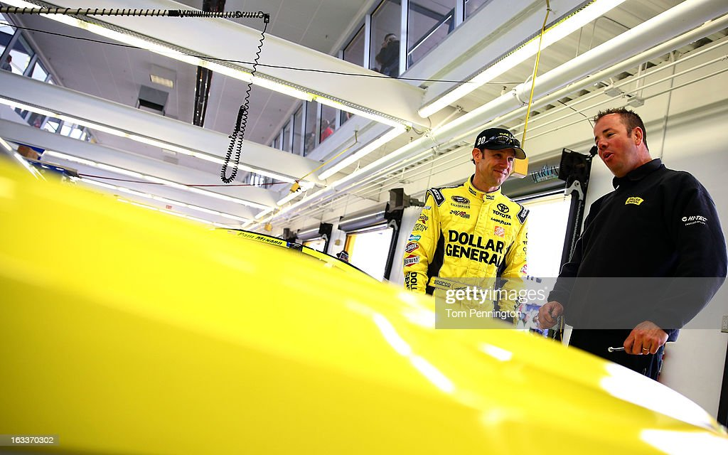 <a gi-track='captionPersonalityLinkClicked' href=/galleries/search?phrase=Matt+Kenseth&family=editorial&specificpeople=204192 ng-click='$event.stopPropagation()'>Matt Kenseth</a>, driver of the #20 Dollar General Toyota, speaks with a crew member in the garage before practice for the NASCAR Sprint Cup Series at Las Vegas Motor Speedway on March 8, 2013 in Las Vegas, Nevada.