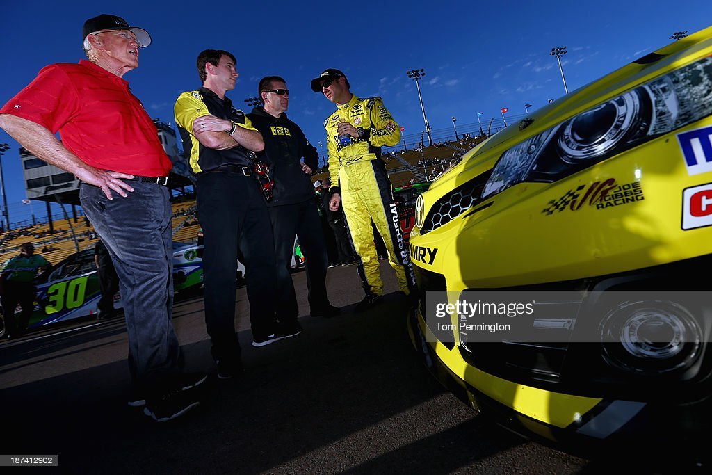<a gi-track='captionPersonalityLinkClicked' href=/galleries/search?phrase=Matt+Kenseth&family=editorial&specificpeople=204192 ng-click='$event.stopPropagation()'>Matt Kenseth</a>, driver of the #20 Dollar General Toyota, (right) speaks with crew members and team owner <a gi-track='captionPersonalityLinkClicked' href=/galleries/search?phrase=Joe+Gibbs&family=editorial&specificpeople=171526 ng-click='$event.stopPropagation()'>Joe Gibbs</a> (left) during qualifying for the NASCAR Sprint Cup Series Advocare 500 at Phoenix International Raceway on November 8, 2013 in Avondale, Arizona.