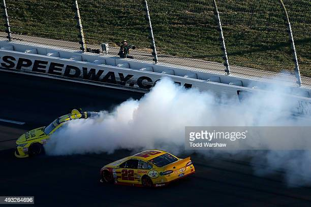 Matt Kenseth driver of the Dollar General Toyota spins as Joey Logano driver of the Shell Pennzoil Ford races by during the NASCAR Sprint Cup Series...