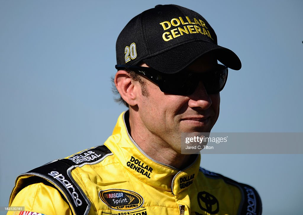 <a gi-track='captionPersonalityLinkClicked' href=/galleries/search?phrase=Matt+Kenseth&family=editorial&specificpeople=204192 ng-click='$event.stopPropagation()'>Matt Kenseth</a>, driver of the #20 Dollar General Toyota, stands on the grid during qualifying for the NASCAR Sprint Cup Series 13th Annual Hollywood Casino 400 at Kansas Speedway on October 4, 2013 in Kansas City, Kansas.