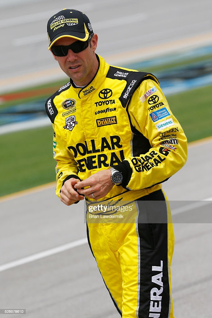 <a gi-track='captionPersonalityLinkClicked' href=/galleries/search?phrase=Matt+Kenseth&family=editorial&specificpeople=204192 ng-click='$event.stopPropagation()'>Matt Kenseth</a>, driver of the #20 Dollar General Toyota, stands on the grid during qualifying for the NASCAR Sprint Cup Series GEICO 500 at Talladega Superspeedway on April 30, 2016 in Talladega, Alabama.