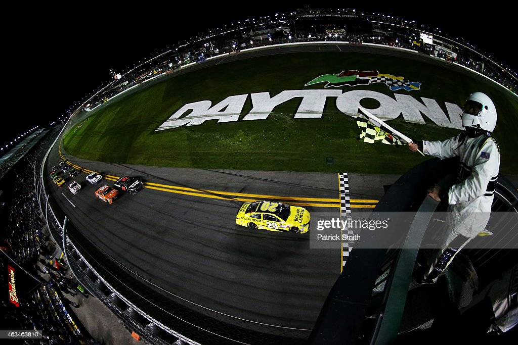 Matt Kenseth driver of the Dollar General Toyota takes the checkered flag to win the 3rd Annual Sprint Unlimited at Daytona at Daytona International...