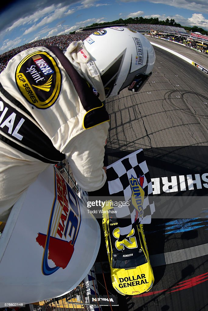 Matt Kenseth, driver of the #20 Dollar General Toyota, takes the checkered flag to win the NASCAR Sprint Cup Series New Hampshire 301 at New Hampshire Motor Speedway on July 17, 2016 in Loudon, New Hampshire.