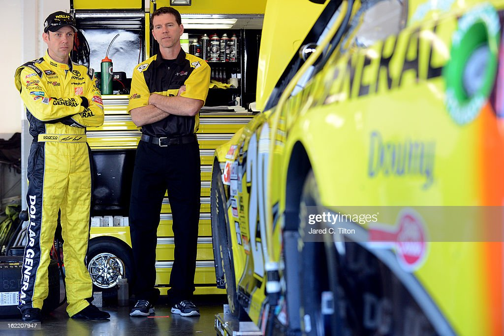 Matt Kenseth (L), driver of the #20 Dollar General Toyota, talks with crew chief Jason Ratcliff (R) in the garage during practice for the NASCAR Sprint Cup Series Daytona 500 at Daytona International Speedway on February 20, 2013 in Daytona Beach, Florida.