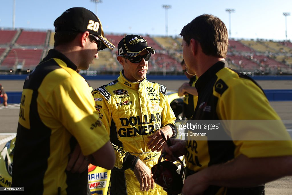 <a gi-track='captionPersonalityLinkClicked' href=/galleries/search?phrase=Matt+Kenseth&family=editorial&specificpeople=204192 ng-click='$event.stopPropagation()'>Matt Kenseth</a>, driver of the #20 Dollar General Toyota, talks with crew chief Jason Ratcliff (right) and his crew after qualifying on the pole for the NASCAR Sprint Cup Series Auto Club 400 at Auto Club Speedway on March 21, 2014 in Fontana, California.