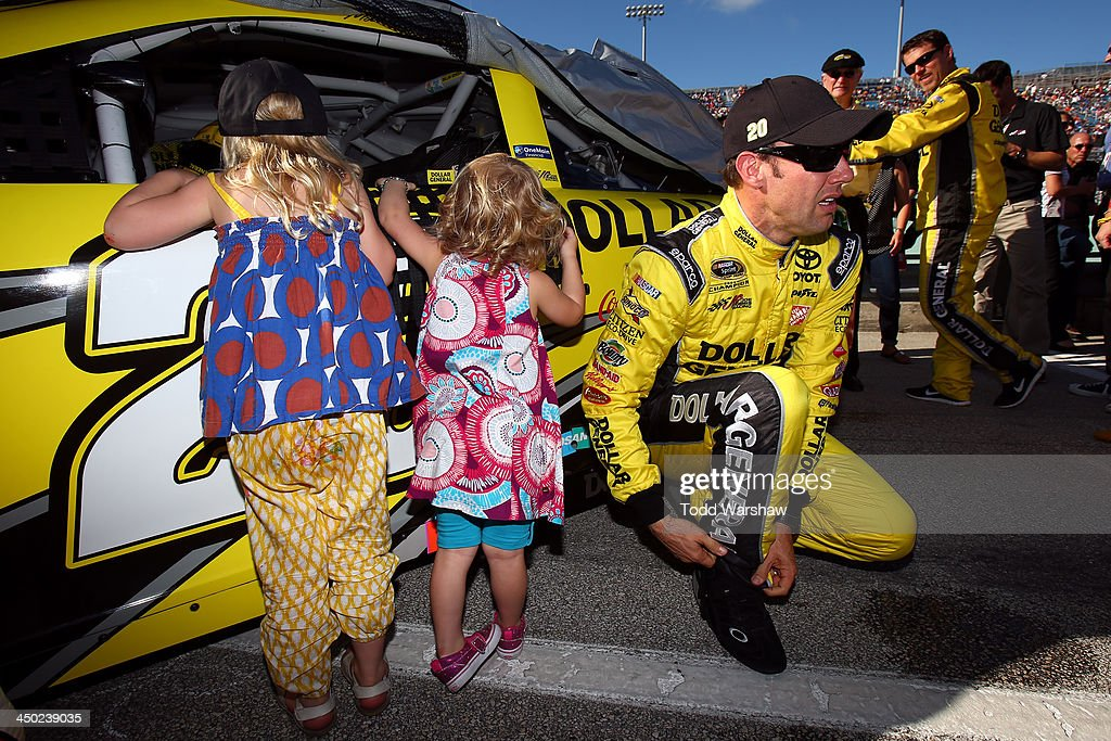 Matt Kenseth, driver of the #20 Dollar General Toyota, talks with his daughters Kaylin and Grace on the grid prior to the NASCAR Sprint Cup Series Ford EcoBoost 400 at Homestead-Miami Speedway on November 17, 2013 in Homestead, Florida.
