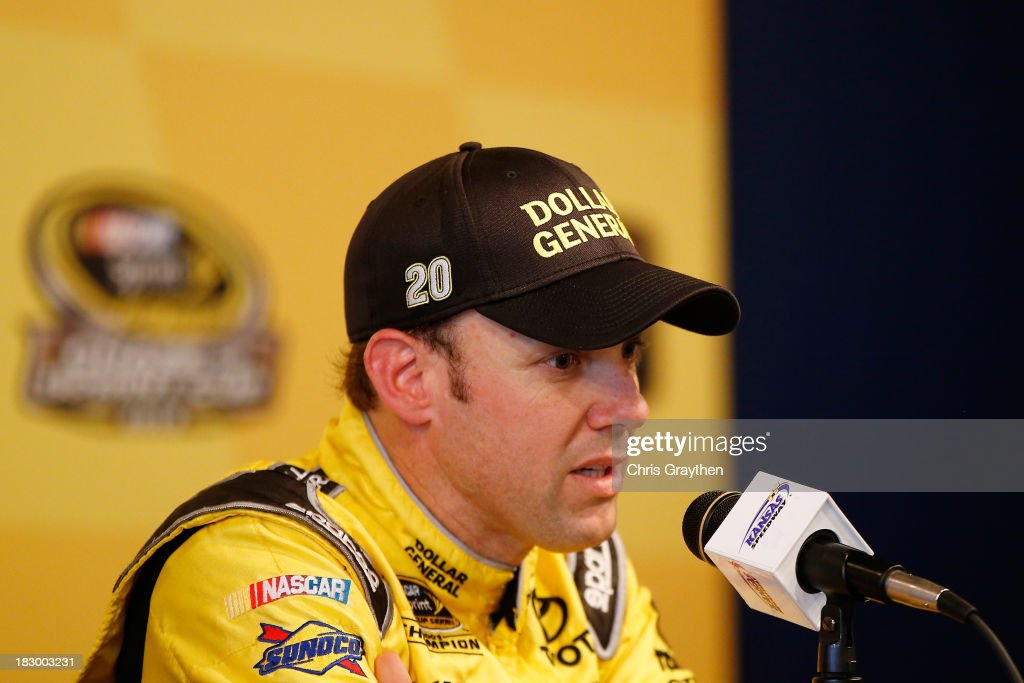 <a gi-track='captionPersonalityLinkClicked' href=/galleries/search?phrase=Matt+Kenseth&family=editorial&specificpeople=204192 ng-click='$event.stopPropagation()'>Matt Kenseth</a>, driver of the #20 Dollar General Toyota, talks with the media following testing for the NASCAR Sprint Cup Series at Kansas Speedway on October 3, 2013 in Kansas City, Kansas.