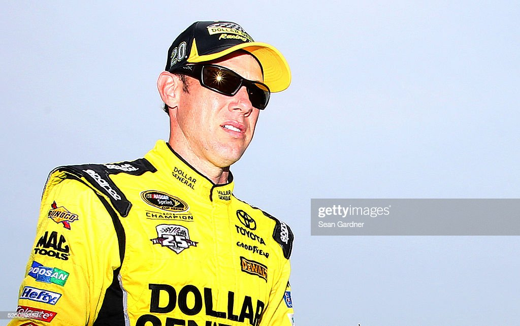 <a gi-track='captionPersonalityLinkClicked' href=/galleries/search?phrase=Matt+Kenseth&family=editorial&specificpeople=204192 ng-click='$event.stopPropagation()'>Matt Kenseth</a>, driver of the #20 Dollar General Toyota, walks through the garage area during practice for the NASCAR Sprint Cup Series GEICO 500 at Talladega Superspeedway on April 29, 2016 in Talladega, Alabama.