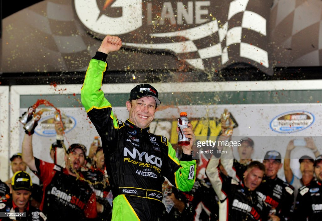 Matt Kenseth driver of the GameStop Toyota celebrates in victory lane after winning the NASCAR Nationwide Series Subway Firecracker 250 at Daytona...